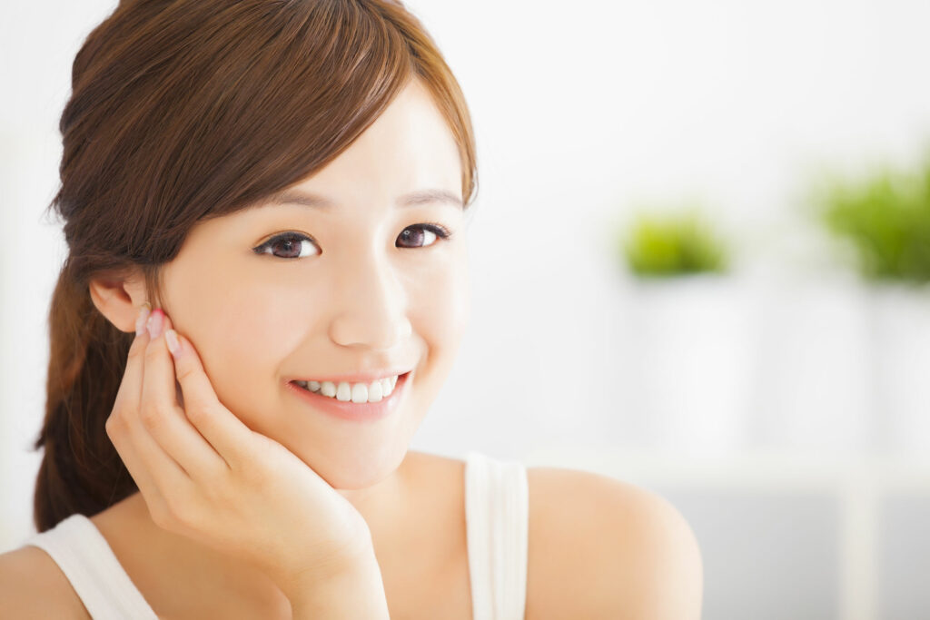 32999349 - smiling  asian young woman
